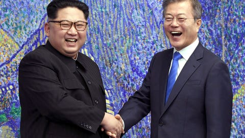 <p>               FILE - In this April 27, 2018, file photo, North Korean leader Kim Jong Un, left, poses with South Korean President Moon Jae-in for a photo inside the Peace House at the border village of Panmunjom in Demilitarized Zone, South Korea. The war-separated rivals will take their reconciliation steps to the Asian Games in Jakarta and Palembang, Indonesia, where they will jointly march in the opening ceremony and field combined teams in basketball, rowing and canoeing. (Korea Summit Press Pool via AP. Pool, File)             </p>