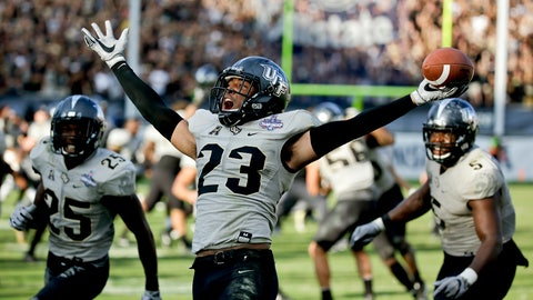 <p>               FILE - In this Dec. 2, 2017, file photo, Central Florida defensive back Tre Neal (23) celebrates after intercepting a Memphis pass to end the American Athletic Conference championship NCAA college football game in Orlando, Fla. When UCF's new coaching staff relegated him to the second team in spring practice, Neal got the nudge he needed to look for a place he could make the most of his final season as a graduate transfer. Neal landed at Nebraska, and he feels right at home. (AP Photo/John Raoux, File)             </p>