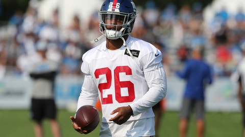 <p>               New York Giants running back Saquon Barkley walks through a drill on the field at the Detroit Lions football training facility, Tuesday, Aug. 14, 2018, in Allen Park, Mich. (AP Photo/Carlos Osorio)             </p>