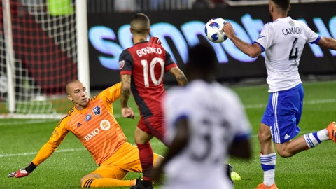 <p>               Toronto FC forward Sebastian Giovinco (10) chips the ball over Montreal Impact goalkeeper Evan Bush (1) to score as Impact defender Rudy Camacho (4) watches during the first half of an MLS soccer match Saturday, Aug. 25, 2018, in Toronto. (Frank Gunn/The Canadian Press via AP)             </p>