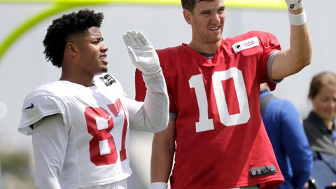 <p>               New York Giants quarterback Eli Manning (10) talks with wide receiver Sterling Shepard (87) during NFL football training camp, Tuesday, Aug. 21, 2018, in East Rutherford, N.J. (AP Photo/Julio Cortez)             </p>