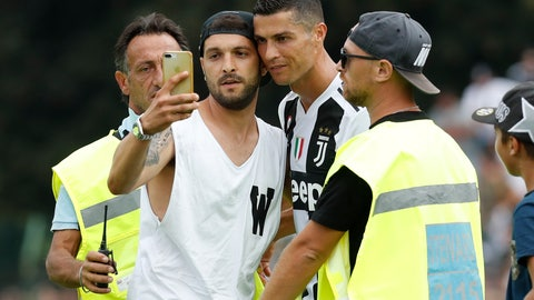 <p>               A fan takes a selfie photo with Cristiano Ronaldo during a friendly match between the Juventus A and B teams, in Villar Perosa, northern Italy, Sunday, Aug.12, 2018. (AP Photo/Antonio Calanni)             </p>