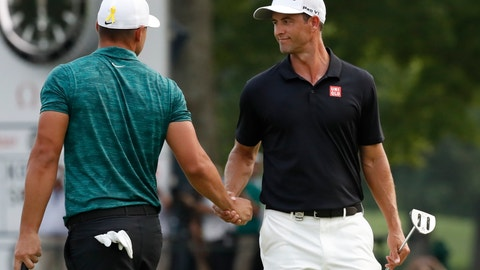 <p>               Brooks Koepka, left, is congratulated by playing partner Adam Scott after Koepka won the PGA Championship golf tournament at Bellerive Country Club, Sunday, Aug. 12, 2018, in St. Louis. (AP Photo/Brynn Anderson)             </p>
