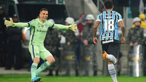 <p>               Andre of Brazil's Gremio, right, celebrates with goalkeeper Marcelo Grohe, after scoring from the penalty spot the victory goal against Argentina's Estudiantes in a Copa Libertadores soccer game, in Porto Alegre, Brazil, Tuesday, Aug. 28, 2018. Gremio won 5-3 in the penalty shootout and qualified for the quarterfinals. (AP Photo/Wesley Santos)             </p>