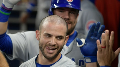 <p>               Chicago Cubs' Tommy La Stella and Kyle Schwarber, rear, celebrate in the dugout after La Stella's two-run home run during the sixth inning of a baseball game against the Atlanta Braves, Thursday, Aug. 30, 2018, in Atlanta. (AP Photo/John Amis)             </p>