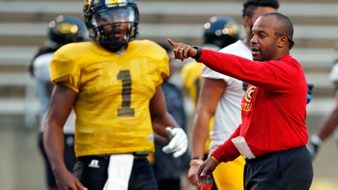 <p>               FILE - In this Nov. 16, 2017, file photo, Grambling's senior quarterback Devante Kincade (1) listens as NCAA college football coach Broderick Fobbs directs offensive players during practice in Grambling, La. Fobbs welcomes his new coaching peers in the Southwestern Athletic Conference _ and any new ideas they bring with them. Half the league's 10 programs have new leaders going into this season, though most of them have been around for a while as assistants. Besides the five new head coaches, Grambling will have a new quarterback with the departure of two-time league offensive player of the year DeVante Kincaid.(AP Photo/Rogelio V. Solis, File)             </p>