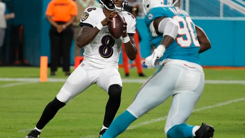 <p>               Baltimore Ravens quarterback Lamar Jackson (8) drops back to pass as he is pressured by Miami Dolphins defensive end Charles Harris (90) during the second half of a preseason NFL football game, Saturday, Aug. 25, 2018, in Miami Gardens, Fla. (AP Photo/Brynn Anderson)             </p>