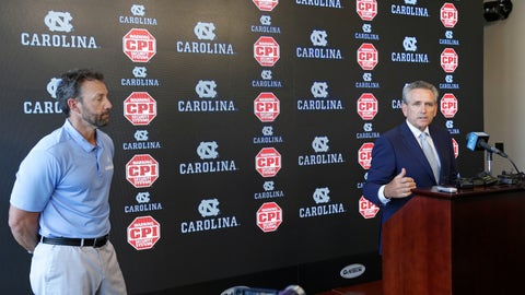 <p>               North Carolina coach Larry Fedora, left, listens as athletic director Bubba Cunningham makes comments during the NCAA college football team's media day in Chapel Hill, N.C., Monday, Aug. 6, 2018. Thirteen North Carolina football players face suspensions for selling team-issued shoes, a secondary NCAA violation. (AP Photo/Gerry Broome)             </p>