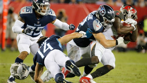 <p>               Tennessee Titans wide receiver Nick Williams (14) loses his helmet as he tries to bring down Tampa Bay Buccaneers running back Shaun Wilson, right, in the second half of a preseason NFL football game Saturday, Aug. 18, 2018, in Nashville, Tenn. (AP Photo/James Kenney)             </p>