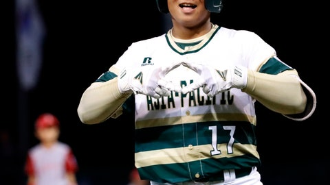 <p>               South Korea's Ji Hying Choi celebrates his two-run home run off Japan pitcher Yuya Ito during the second inning of a baseball game at the Little League World Series in South Williamsport, Pa., Wednesday, Aug. 22, 2018. (AP Photo/Tom E. Puskar)             </p>