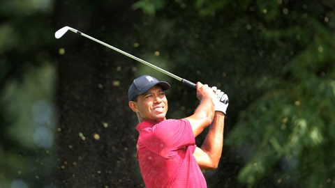 <p>               Tiger Woods watches his shot on the sixth hole during the final round of the Northern Trust golf tournament, Sunday, Aug. 26, 2018, in Paramus, N.J. (AP Photo/Mel Evans)             </p>
