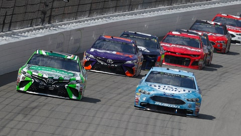 <p>               Kyle Busch, left, races Kevin Harvick into Turn 1 during a NASCAR Cup Series auto race at Michigan International Speedway in Brooklyn, Mich., Sunday, Aug. 12, 2018. (AP Photo/Paul Sancya)             </p>