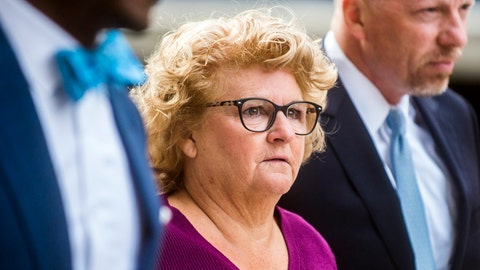 <p>               Former Michigan State gymnastics coach Kathie Klages arrives at the Lansing Police Department, Thursday, Aug. 30, 2018, in Lansing, Mich. Klages is charged with lying to investigators in the Larry Nassar sexual-assault scandal.  (Jake May/The Flint Journal via AP)             </p>