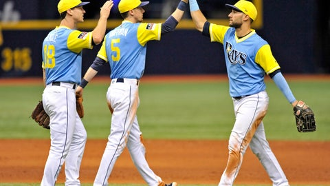 <p>               Tampa Bay Rays' Joey Wendle (18), Matt Duffy (5) and Kevin Kiermaier, right, celebrate a win over the Boston Red Sox in a baseball game Sunday, Aug. 26, 2018, in St. Petersburg, Fla. (AP Photo/Steve Nesius)             </p>