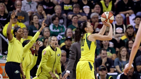 <p>               Seattle Storm's Sue Bird, right, shoots a three-point basket as teammates cheer on the bench in the first half of a WNBA basketball playoff semifinal against the Phoenix Mercury, Sunday, Aug. 26, 2018, in Seattle. (AP Photo/Elaine Thompson)             </p>