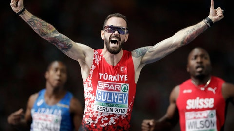 <p>               Turkey's Ramil Guliyev celebrates winning the men's 200 meter final race at the European Athletics Championships in Berlin, Germany, Thursday, Aug. 9, 2018. (AP Photo/Michael Sohn)             </p>