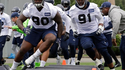 <p>               FILE - In this May 24, 2018, file photo, from left, Seattle Seahawks defensive tackle Jarran Reed (90) and defensive tackle Tom Johnson (91) take part in an agility drill during NFL football practice in Renton, Wash.  When the Seahawks looked to bolster the interior of its defense in the offseason, it looked to Minnesota for the help. The Seahawks signed former Vikings defensive linemen Tom Johnson and Shamar Stephen. They are likely to get their most extensive action of the preseason on Friday, Aug. 24, against their former team. (AP Photo/Ted S. Warren, File)             </p>