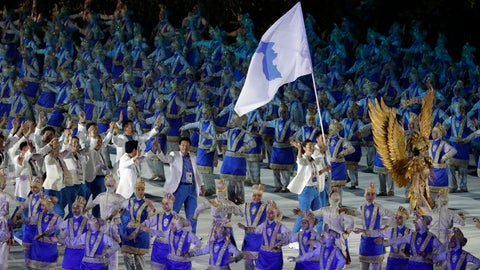 """<p>               The combined Koreas march into Gelora Bung Karno Stadium under the """"unification"""" flag during the opening ceremony for the 18th Asian Games in Jakarta, Indonesia, Saturday, Aug. 18, 2018. (AP Photo/Lee Jin-man)             </p>"""