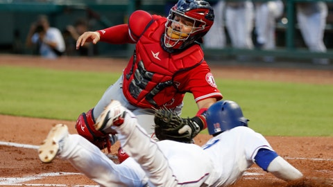 <p>               Texas Rangers' Jurickson Profar, foreground, slides and scores ahead of the tag by Los Angeles Angels catcher Rene Rivera on a double by Joey Gallo during the second inning of a baseball game, Friday, Aug. 17, 2018, in Arlington, Texas. (AP Photo/Jim Cowsert)             </p>
