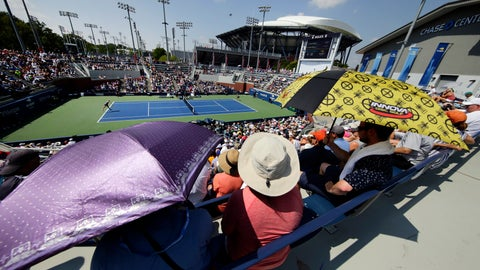 <p>               Fans use umbrellas to shelter from the sun as they watch the match between Victoria Azarenka, of Belarus, and Daria Gavrilova, of Australia, during the second round of the U.S. Open tennis tournament, Wednesday, Aug. 29, 2018, in New York. (AP Photo/Frank Franklin II)             </p>