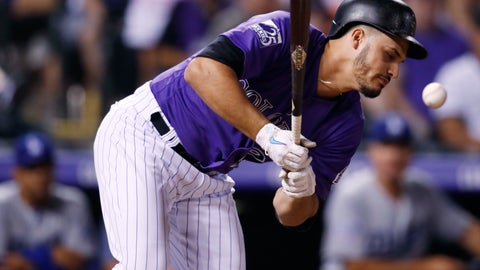 <p>               Colorado Rockies pinch-hitter Nolan Arenado reacts after beiing hit with a pitch thrown by Los Angeles Dodgers reliever JT Chargois in the ninth inning of a baseball game Saturday, Aug. 11, 2018, in Denver. (AP Photo/David Zalubowski)             </p>