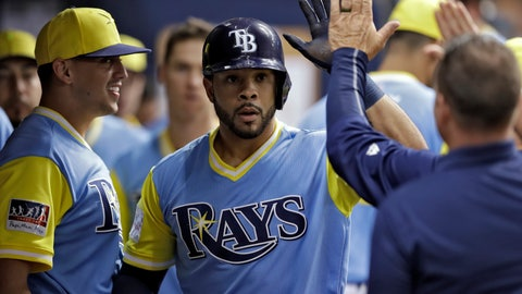 <p>               Tampa Bay Rays' Tommy Pham, center, celebrates with teammates in the dugout after his home run off Boston Red Sox relief pitcher Brandon Workman during the seventh inning of a baseball game Saturday, Aug. 25, 2018, in St. Petersburg, Fla. (AP Photo/Chris O'Meara)             </p>