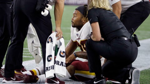 <p>               Washington Redskins running back Derrius Guice, center, receives attention on the field after an injury during the first half of a preseason NFL football game against the New England Patriots, Thursday, Aug. 9, 2018, in Foxborough, Mass. (AP Photo/Steven Senne)             </p>