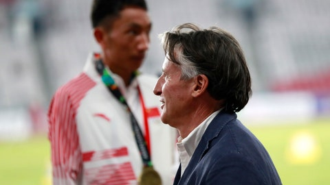 <p>               In this Saturday Aug. 25, 2018 photo, President of the International Association of Athletics Federations (IAAF) Sebastian Coe waits at the medal ceremony for the men's marathon during the athletics competition at the 18th Asian Games in Jakarta, Indonesia. Coe says China and Japan are the two most improved countries in athletics over the last six or seven years.(AP Photo/Bernat Armangue)             </p>