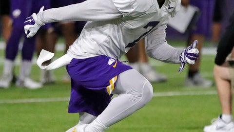 <p>               LSU wide receiver Jonathan Giles (7) runs through drills during their NCAA college football practice in Baton Rouge, La., Monday, Aug. 6, 2018. (AP Photo/Gerald Herbert)             </p>