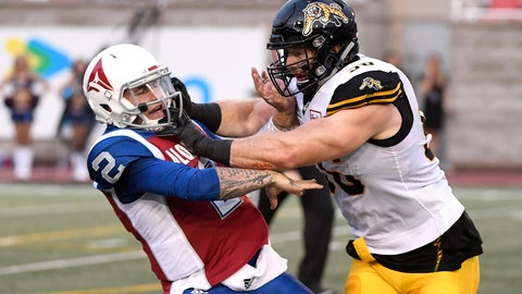 <p>               Montreal Alouettes quarterback Johnny Manziel (2) is hit by Hamilton Tiger-Cats defensive end Jason Neill (96) during the first half of a Canadian Football League game Friday, Aug. 3, 2018, in Montreal. (Paul Chiasson/The Canadian Press via AP)             </p>