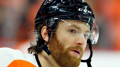 <p>               FILE - This is an April 22, 2018, file photo showing Philadelphia Flyers' Sean Couturier during warm-ups before the start of an NHL hockey game in Philadelphia. Couturier is out four weeks after suffering a knee injury for the second time in five months.  General manager Ron Hextall provided the update Wednesday, Aug. 22, 2018, saying Couturier was injured Aug. 10 in an exhibition game. (AP Photo/Tom Mihalek, File)             </p>