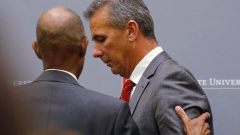 <p>               Ohio State University President Michael Drake offers words to football coach Urban Meyer, who leaves the stage following a news conference in Columbus, Ohio, Wednesday, Aug. 22, 2018. Ohio State suspended Meyer on Wednesday for three games for mishandling domestic violence accusations, punishing one of the sport's most prominent leaders for keeping an assistant on staff for several years after the coach's wife accused him of abuse. Athletic director Gene Smith was suspended from Aug. 31 through Sept. 16. (AP Photo/Paul Vernon)             </p>