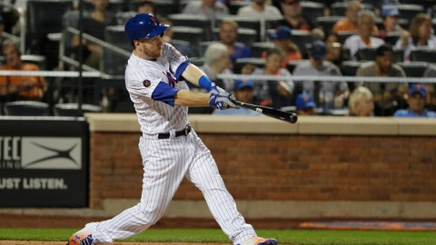 <p>               New York Mets' Todd Frazier hits a home run during the seventh inning of the team's baseball game against the San Francisco Giants on Wednesday, Aug. 22, 2018, in New York. (AP Photo/Frank Franklin II)             </p>