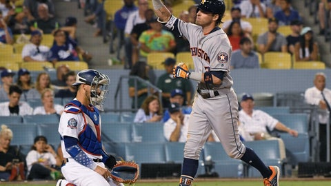 <p>               Houston Astros' Josh Reddick (22) crosses home plate in front of Los Angeles Dodgers catcher Austin Barnes (15) after a three-run home run during the eighth inning of a baseball game Saturday, Aug. 4, 2018, in Los Angeles. (AP Photo/John McCoy)             </p>