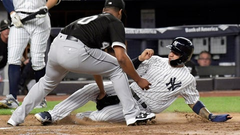 <p>               Chicago White Sox pitcher Reynaldo Lopez tags out New York Yankees runner Gleyber Torres, right, attempting to score when the ball got away from catcher Kevan Smith during the fifth inning of a baseball game Wednesday, Aug. 29, 2018, at Yankee Stadium in New York. (AP Photo/Bill Kostroun)             </p>
