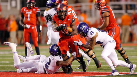 <p>               Utah running back Zack Moss, center, carries the ball as Weber State's Jawian Harrison Jr. (2) and Jordan Preator (24) defend during the second half of an NCAA college football game Thursday, Aug. 30, 2018, in Salt Lake City. (AP Photo/Rick Bowmer)             </p>