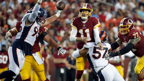 <p>               Washington Redskins quarterback Alex Smith (11) throws the ball as he is hit by Denver Broncos defensive end DeMarcus Walker (57) with defensive end Derek Wolfe (95) nearby, during the first half of a preseason NFL football game Friday, Aug. 24, 2018, in Landover, Md. (AP Photo/Alex Brandon)             </p>