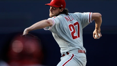 <p>               Philadelphia Phillies starting pitcher Aaron Nola works against a San Diego Padres batter during the first inning of a baseball game Saturday, Aug. 11, 2018, in San Diego. (AP Photo/Gregory Bull)             </p>