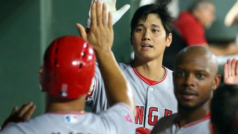 <p>               Los Angeles Angels' Shohei Ohtani (17) high-fives Albert Pujols (5) after Ohtani's pinch-hit three-run home run against the Texas Rangers during the seventh inning of a baseball game Saturday, Aug. 18, 2018, in Arlington, Texas. (AP Photo/Richard W. Rodriguez)             </p>