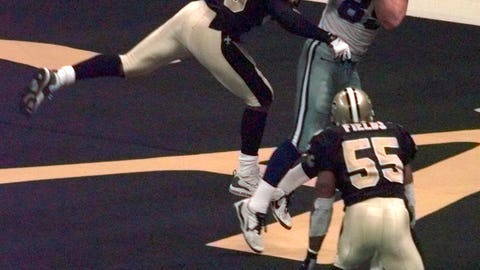 <p>               FILE - In this Dec. 24, 1999, file photo, New Orleans Saints linebacker Keith Mitchell (59) deflects a pass away Dallas Cowboys tightend David LaFleur (89) during the fourth quarter in New Orleans. Mitchell deflected the ball to teammate Mark Fields (55) who intercepted the pass, sealing the Saints 31-24 victory. On a routine tackle on Sept. 14, 2003, Keith Mitchell wound up flat on his back unable to move. His playing career was over. He had a spinal contusion. Now Mitchell is a certified yoga instructor with more than a decade of experience. He founded the Light It Up Foundation and the KM59 wellness movement that helps children, trauma survivors, first responders and veterans.  (AP Photo/Bill Haber, File)             </p>