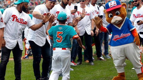 <p>               Panama's Adam Villarreal (5) high fives Philadelphia Phillies Carlos Santana and Asdrubal Cabrera during player introductions of their game against Japan in an International pool play baseball game at the Little League World Series tournament in South Williamsport, Pa., Sunday, Aug. 19, 2018. Japan won the game 4-2. (AP Photo/Tom E. Puskar)             </p>