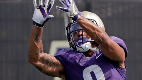 <p>               FILE - In this Aug. 10, 2018, file photo, Washington's Myles Gaskin reaches for a pass reception at NCAA college football practice, in Seattle. No. 6 Washington's potential Heisman Trophy contenders Gaskin and quarterback Jake Browning play against No. 9 Auburn in the only opening-week game between top ten teams. (AP Photo/Elaine Thompson, File)             </p>