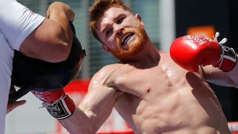 <p>               FILE - In this Aug. 28, 2017, file photo, boxer Canelo Alvarez works out as he hosts an open-to-the-public media workout at L.A. LIVE in Los Angeles.  In the quiet calm of Canelo Alvarez's training gym in a suburban office park, the Mexican superstar can escape the bitter emotions and sharp words surrounding his rematch with Gennady Golovkin.  (AP Photo/Damian Dovarganes, File)             </p>