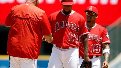 <p>               Los Angeles Angels manager Mike Scioscia, left, pulls starting pitcher Felix Pena, with first baseman Jefry Marte watching during the first inning of a baseball game against the Seattle Mariners in Anaheim, Calif., Sunday, July 29, 2018. Pena did not last the first inning after facing nine batters. (AP Photo/Alex Gallardo)             </p>