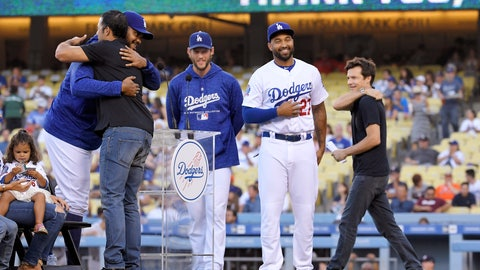 <p>               Los Angeles Dodgers' Andre Ethier, second from eft, hugs Kenley Jansen, left, as Clayton Kershaw, center, Matt Kemp, second from right, and actor Jason Bateman stand by during a retirement ceremony for Ethier prior to a baseball game between the Dodgers and the Houston Astros on Friday, Aug. 3, 2018, in Los Angeles. (AP Photo/Mark J. Terrill)             </p>