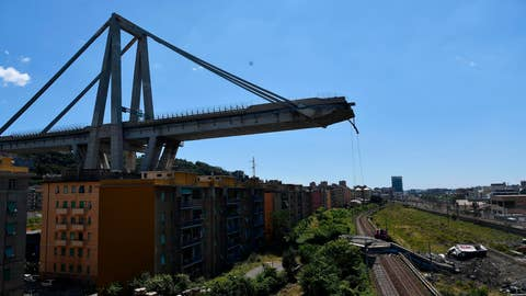 <p>               A view of the evacuated houses built under the remains part of the collapsed Morandi highway bridge, in Genoa, northern Italy, Wednesday, Aug. 15, 2018. A bridge on a main highway linking Italy with France collapsed in the Italian port city of Genoa during a sudden, violent storm, sending vehicles plunging 90 meters (nearly 300 feet) into a heap of rubble below. (AP Photo/Nicola Marfisi)             </p>