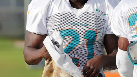 <p>               In this Monday, July 30, 2018, photo, running back Frank Gore (21) stands on the field at the NFL football team's training camp in Davie, Fla. The NFL's active career rushing leader may still be a starter at age 35. Gore is listed as sharing the No. 1 running back spot with incumbent Kenyan Drake on the first depth chart of training camp for the Miami Dolphins. (AP Photo/Lynne Sladky)             </p>