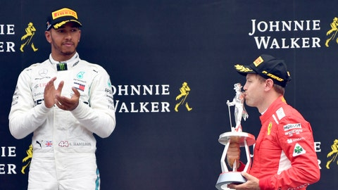 <p>               Ferrari driver Sebastian Vettel of Germany, right, kisses the trophy on the podium after winning the Belgian Formula One Grand Prix in Spa-Francorchamps, Belgium, Sunday, Aug. 26, 2018. Mercedes driver Lewis Hamilton of Britain, left, placed second. (AP Photo/Geert Vanden Wijngaert)             </p>