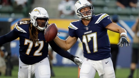 <p>               Los Angeles Chargers quarterback Philip Rivers looks to throw a pass as offensive tackle Joe Barksdale (72) protects during the first half of an NFL preseason football game against the Seattle Seahawks on Saturday, Aug. 18, 2018, in Carson, Calif. (AP Photo/Gregory Bull)             </p>
