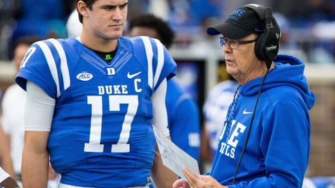 <p>               File-This Nov. 18, 2017, file photo shows Duke Head Coach David Cutcliffe speaking with quarterback Daniel Jones prior to an an NCAA college football game against Georgia Tech in Durham, N.C.  Jones threw for 2,691 yards and 14 touchdowns while running for seven more scores last season. (AP Photo/Ben McKeown, File)             </p>
